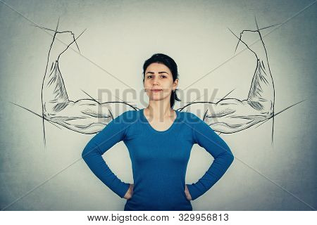 Brave Woman, Hands On Hips, Facing Fears Like A Powerful Hero As Muscular Arms Sketches On The Wall