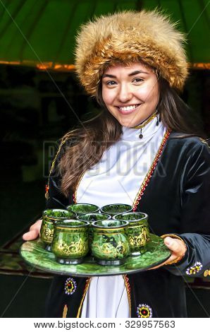Ufa, Russia. July 12, 2019. A Girl In A Traditional Bashkir Dress With A Fox Fur Hat Meeting Guests