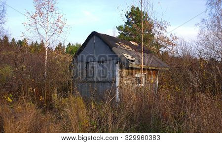 Wooden Village Houses In The Heartland Of Russia