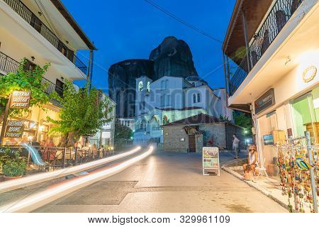 Kastraki Greece - July 26 2019;  Long Exposure Conveying The People, Shops, Business Signs And Light