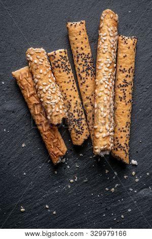 Crispy Breadsticks With Poppy Seeds On Photography