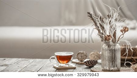 Home Decor Beautiful Vase With Flowers And A Cup Of Tea.