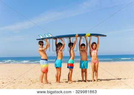Five Kids With Surfboard On The Sand Sea Beach