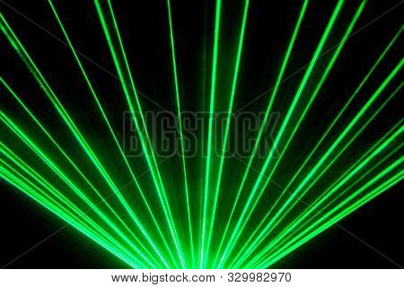 Green Laser Show Nightlife Club Stage And Shining Sparkling Rays. Luxury Entertainment In Nightclub