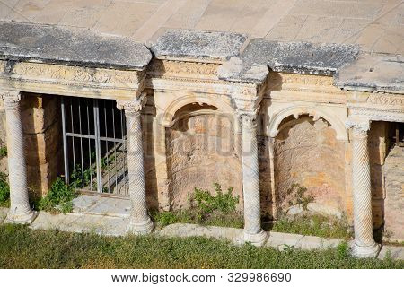 Antique Columns And Arches In The Hierapolis Amphitheater. Ancient Antique Amphitheater In The City