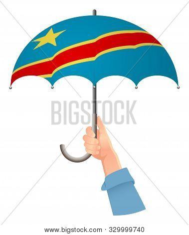 Democratic Republic Of The Congo Flag. Hand Holding Umbrella. Social Security Concept. National Flag