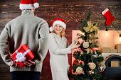 Generosity and kindness. Prepare surprise for darling. Winter surprise. Man carry gift box behind back. Woman smiling face santa. Christmas surprise concept. Surprising his wife. Giving and sharing poster