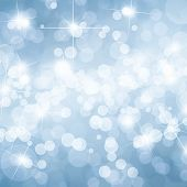 Blue defocused lights background with copy space poster