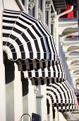Striped awnings of a restaurant poster