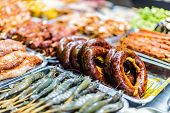 Traditional Vietnamese street food sold in Sapa in Lao Cai Province in northwest Vietnam poster