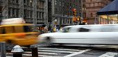 Taxi and limousine blurred by speed on the street of New York during rain poster