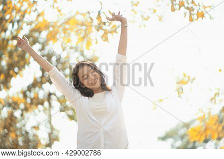 Summer Breeze Enjoyment Of Asian Woman In The Park Feeling Carefree And Positive Lifestyle.