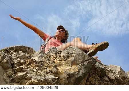Happy Female Tourist On Top Of A Hill In Silence And Loneliness Admires A Tranquil Natural Landscape