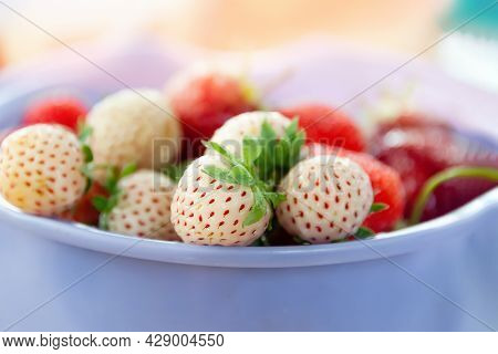 Pin-berry Strawberry Close-up. Natural Fruit Background Of Ripe White Berries With Red Seeds