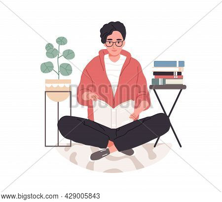 Smart Student Preparing For Exam At Home. Young Man In Eyeglasses Studying And Reading Textbooks. Re