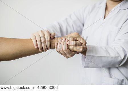 A Professional Physiotherapist Is Doing A Massage To Loosen The Hand Muscles Of Patients Undergoing