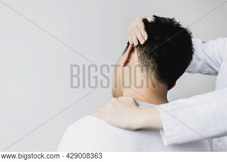 A Professional Physiotherapist Is Stretching The Neck Muscles Of A Patient Undergoing Therapy, Most