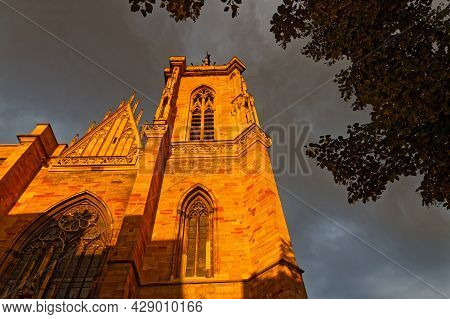 Colmar, France, June 25, 2021 : Cathedral Bell Tower At Sunset Light. City Has A Rich Architectural