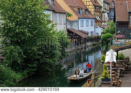 Colmar, France, June 25, 2021 : Cruise On The Lauch River. Petite Venise Is A Picturesque Tourist Ar
