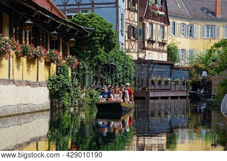 Colmar, France, June 27, 2021 : Cruise On The Lauch River. Petite Venise Is A Picturesque Tourist Ar
