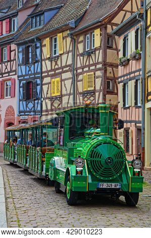 Colmar, France, June 27, 2021 : Small Tourist Train In Old Streets. City Has A Rich Architectural He