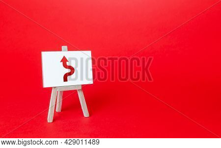 An Easel With A Curved Arrow Avoiding An Obstacle. Deviation From Route, Side Mission. Purposefulnes
