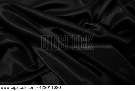 Smooth Elegant Black Silk Or Satin Luxury Cloth Texture Can Use As Abstract Background. Luxurious Ba