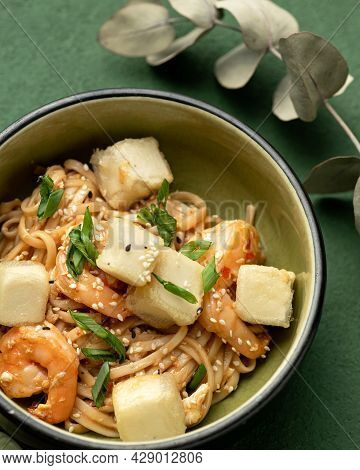 Oriental Noodles Or Spaghetti With Shrimp Vegetables And Sesame Seeds. Close-up Of Bowl With Asian F