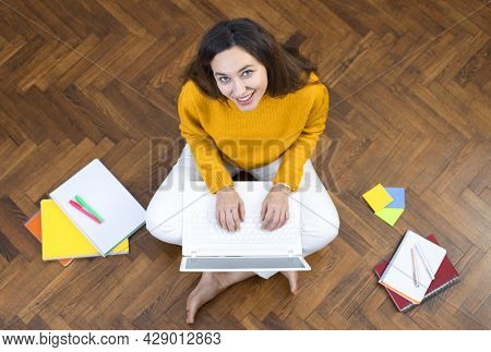 Top View Young Woman Freelance Working On Laptop With Paperwork At Home, Work At Home Concept.