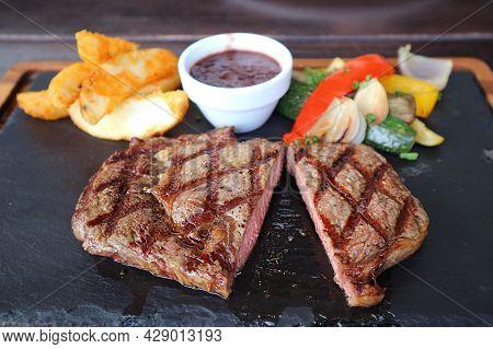 Delectable Medium Grilled Tenderloin Steak On Hot Stone Plate