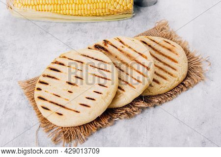 Arepas Made With Corn Flour And Cooked In A Pan, It Is Similar To A Corn Tortilla