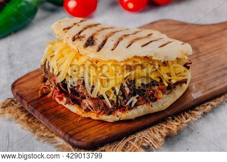 Delicious Arepa Of Shredded Meat With Yellow Cheese