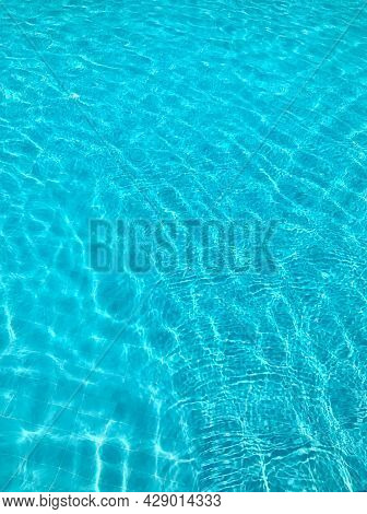 Bright Blue Clear Transparent Water In The Swimming Pool
