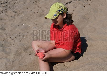 The Girl Has Red Slime In Her Hands. The Girl Is Always Enthusiastic About Playing With Slime, Even