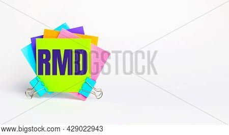 There Are Bright Multi-colored Stickers With The Text Rmd Required Minimum Distributions On A White