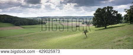 Rural Countryside Summer Landscape With Green Meadows And Trees In French Ardennes Near Charleville