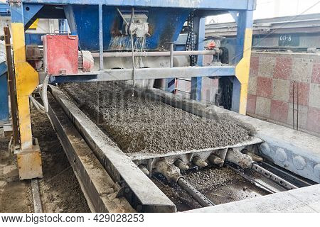 Casting Of Concrete Into Form With Prestressed Reinforcement During Production Of Floor Slabs. Const