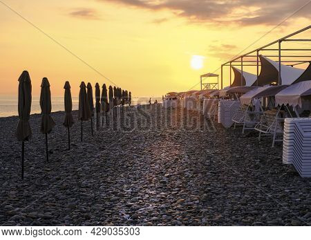 Beautiful Landscape Of The Ocean Or Sea. Sea Beach With Straw Umbrellas And A Number Of Beach Beds.