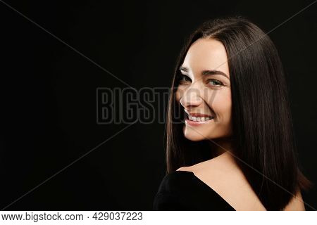 Portrait Of Pretty Young Woman With Gorgeous Chestnut Hair And Charming Smile On Black Background, S