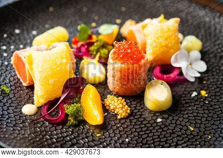 Salted Scottish salmon with trout roe. Marinated cucumber and onion, wonton chips. Delicious healthy Italian traditional food closeup served for lunch in modern gourmet cuisine restaurant