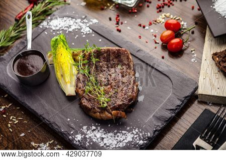 Black Angus Entrecote steak. Marbled steak from Uruguay. Delicious healthy traditional food closeup served for lunch in modern gourmet cuisine restaurant