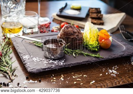 Black Angus Chateaubriant steak. Tenderloin from Brazil. Delicious healthy traditional food closeup served for lunch in modern gourmet cuisine restaurant