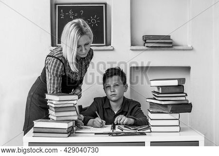 Student during homework with the help of a tutor.. Black and white photo.