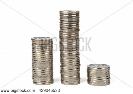 The White Metal Coins Are Stacked In Three Columns Of Different Heights. Coins Of Ukraine