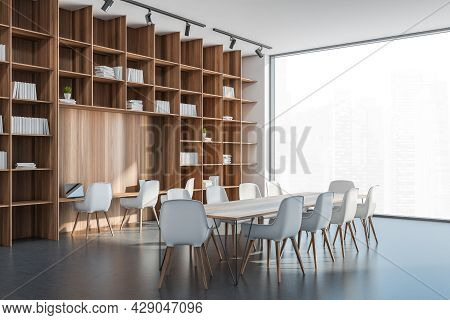 Corner View On The Large Wooden Bookcase With Niche Desk And Conference Table In The White And Grey