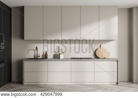 Simple Light Beige Kitchen And Wall, Light Grey Detail, Built-in Wood Cabinets With Oven And Microwa
