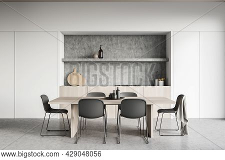 Cozy Kitchen Room Interior With Dining Table, Six Chairs, Concrete Floor, Electric Cooker And Crocke