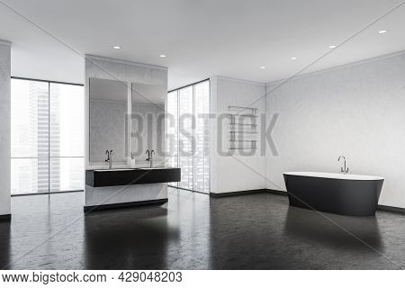 A Spacious Bathroom In Black And White With Panoramic Windows, An Oval Ceramic Bath, An Original Tow