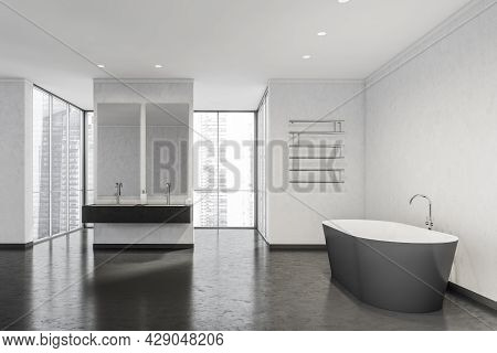 Bathroom Interior With Panoramic Windows Behind A Partition With Two Sinks And Mirrors, A Ceramic Ba