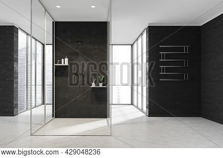 Shower Room Space With White Stone Floors, Black Walls, A Centralized Cabin And Walkways To The Pano